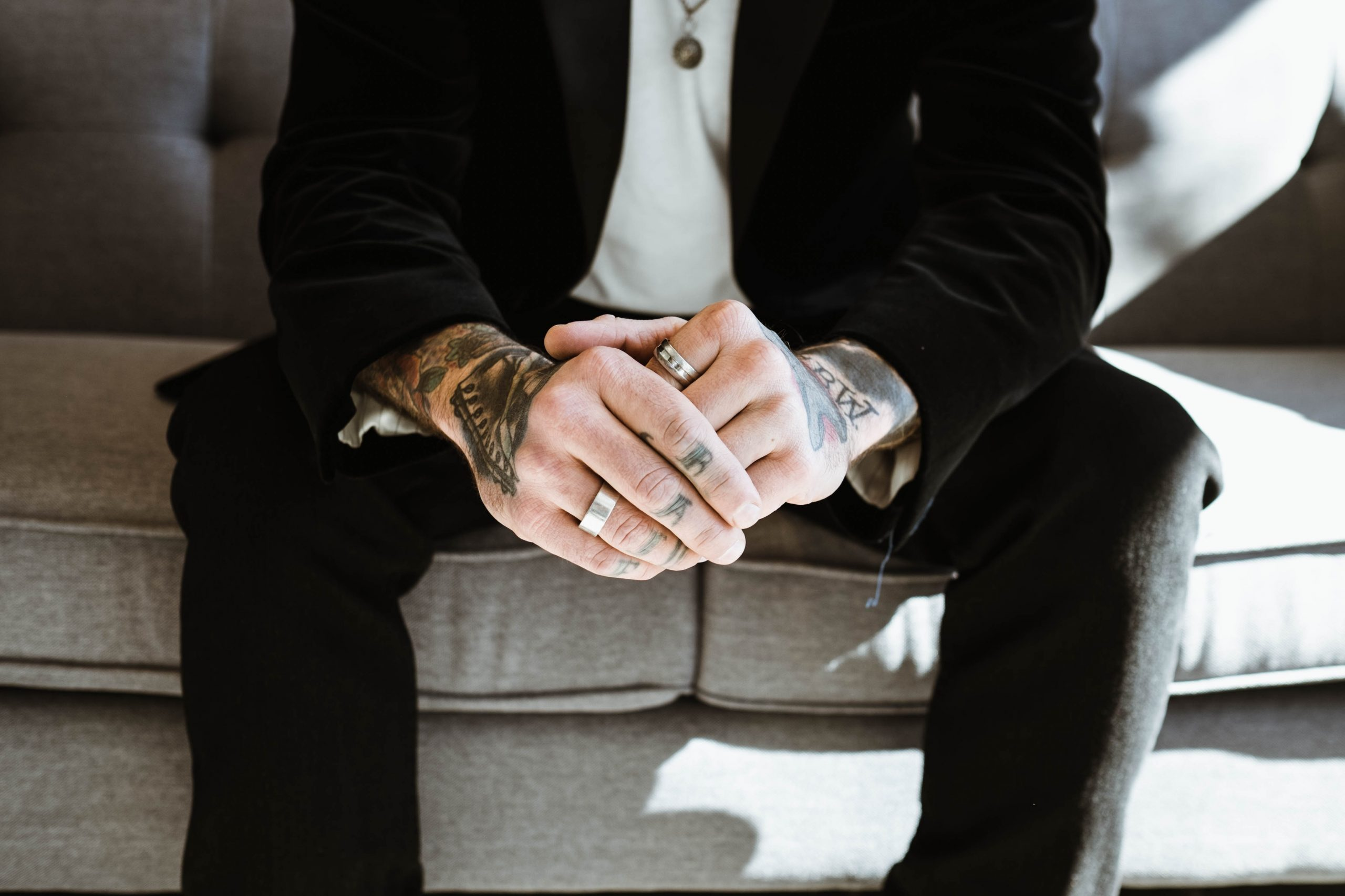 professional man with knuckle tattoos and sleeves